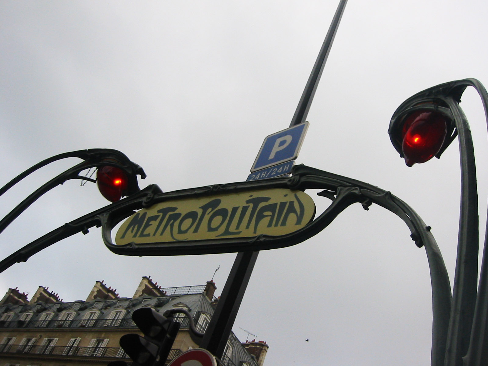 paris sign and streetlight