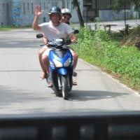 Strolling through Phuket local pottery shops by rented motobike
