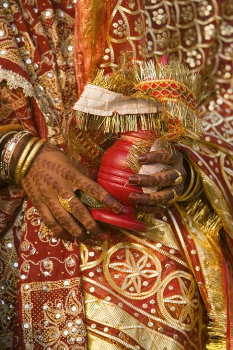 Bride with henna-decorated hands, Varanasi, India