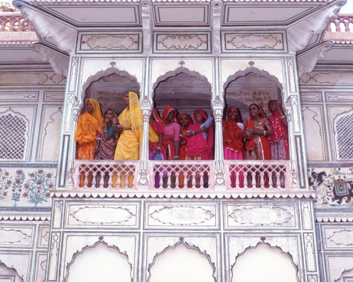 traditional indian woman in the historical building balcony