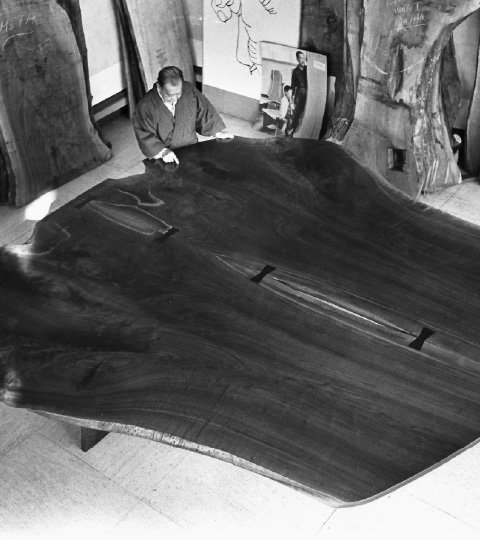 Large wooden table for peace by George Nakashima