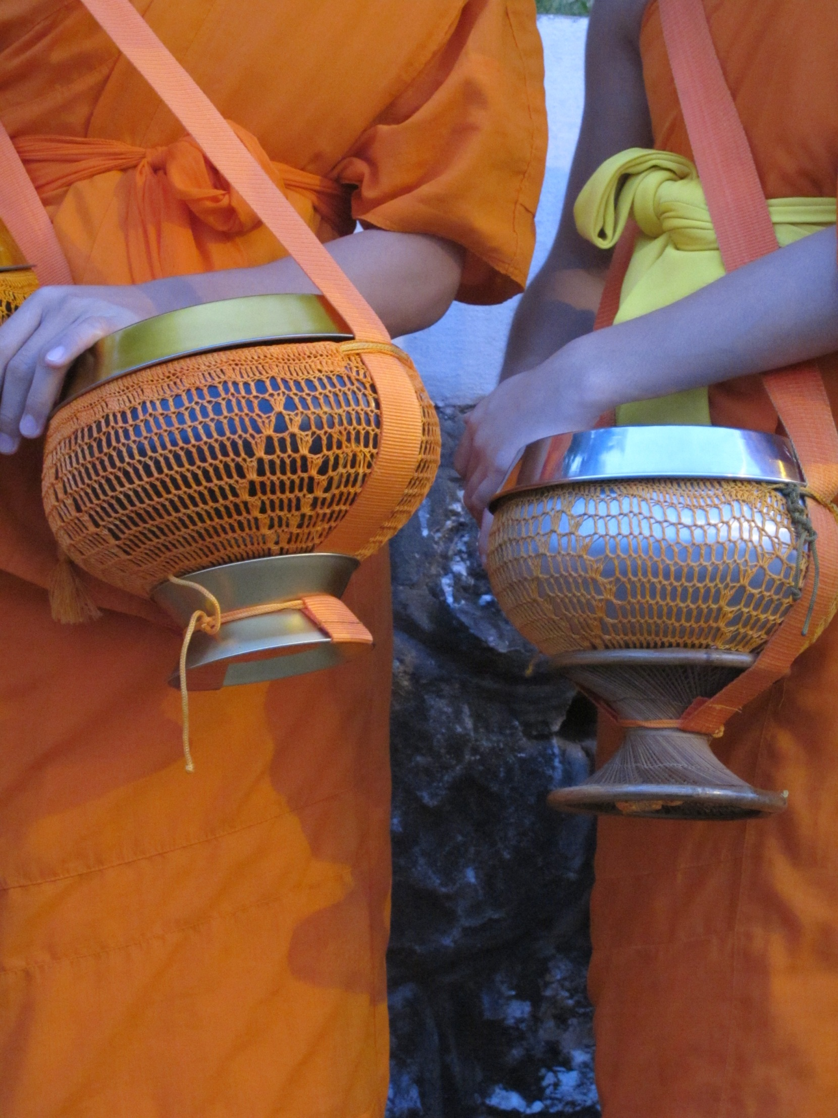 monks wearing saffron color fabric in Laos