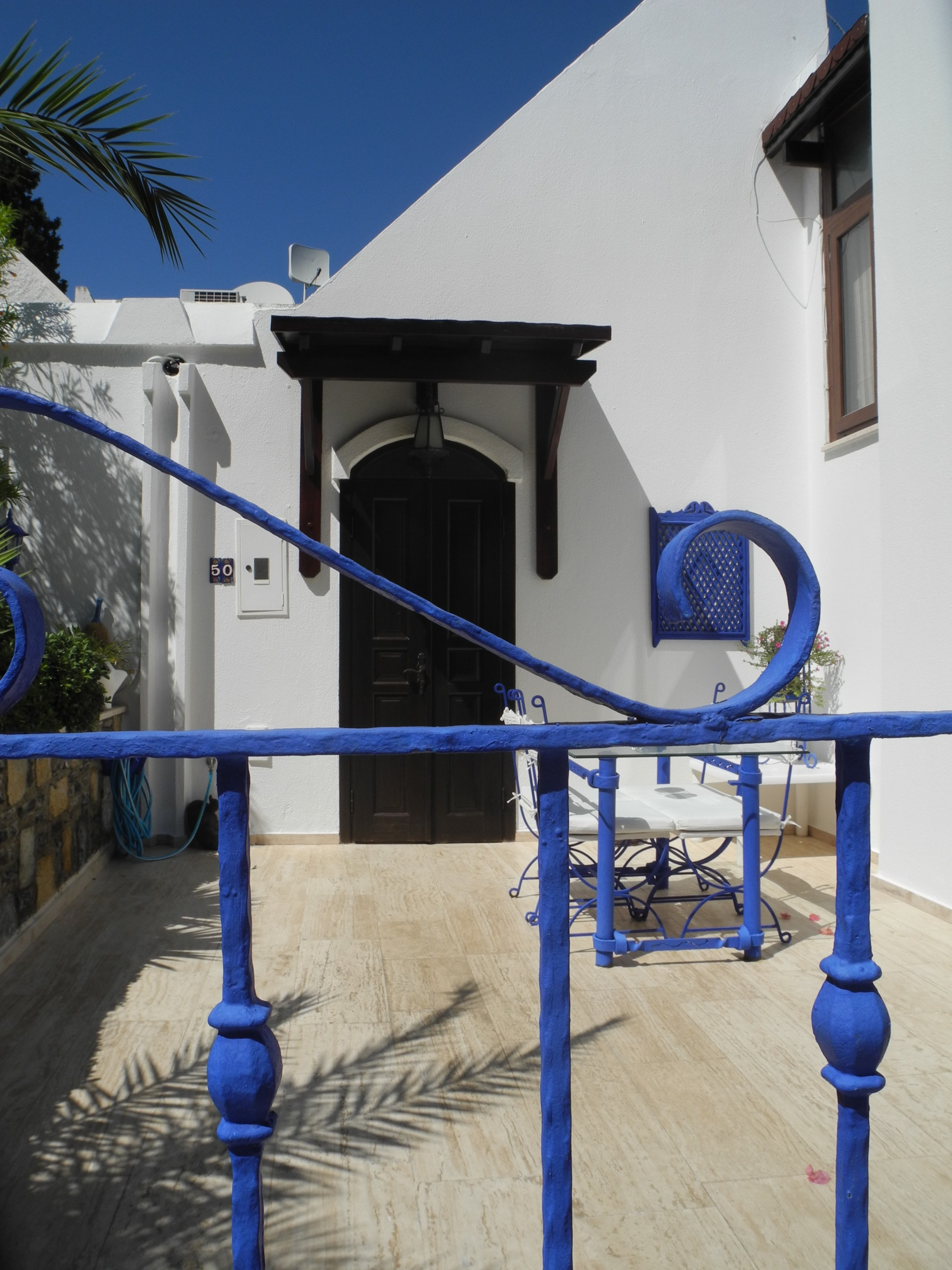 White Bodrum house with blue painted door