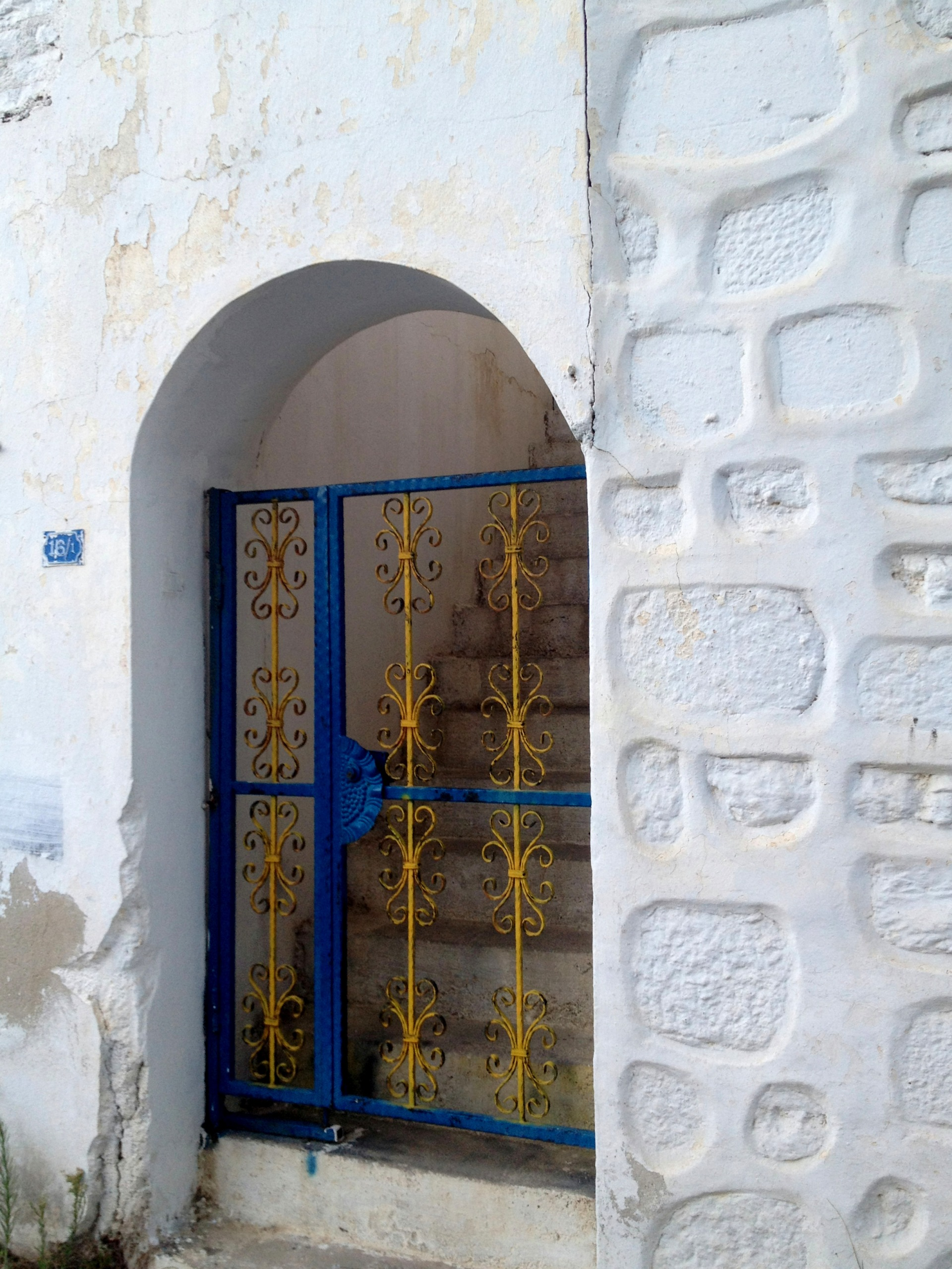 White summer houses and blue painted door in Bodrum